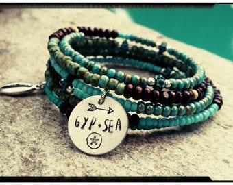 Gyp•Sea Beaded Coil Wrap Bracelet -Six Layers//Turquoise//Czech Picasso Beads//WoodenBeads - Silver Cowrie & Sand Dollar Charms -Memory Wire