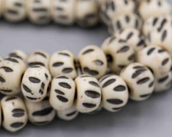 27 Bone Beads White with Black Carving 7x10mm