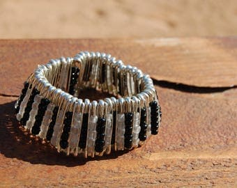 black and white bracelet made with safety pins hand