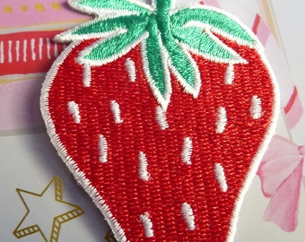 Patch for ironing, sewing, pasting with a red strawberry