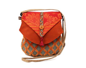 Zipped, orange and gray, red flap shoulder bag. Bag fabric women associated with light and practical.