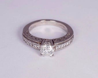 Platinum Engagement Ring with a .94ct. Center Diamond, size 6.25