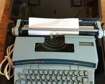 1970's baby blue Smith Corona Coronet Super 12 electric typewriter with case and original paperwork!