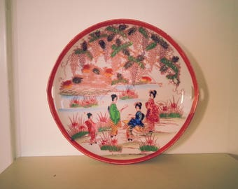 Pretty Oriental Handpainted Plate - with symbol on underside and small hanging or carrying handles