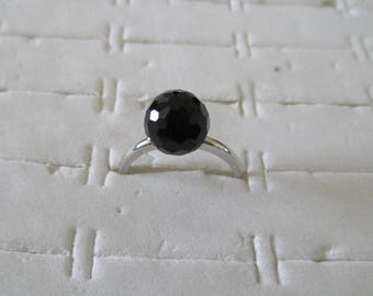 silver ring with black glass bead