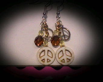 Peace sign funky earrings. White magnesite charm w/brown & yellow accent beads.