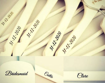 Custom engraved wooden hangers for the wedding bridal party.