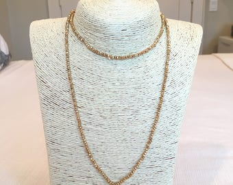 gold beaded necklace w/ pink tassel
