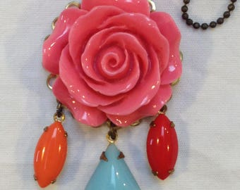C1950s brass and plastic pink rose pendant with blue and red drops with chain