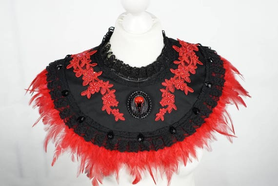 Raven red black feather cape, Cape with red feathers and red beads applications removable Ravens brooch