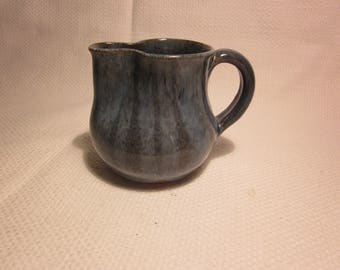 Small signed pottery creamer/pitcher