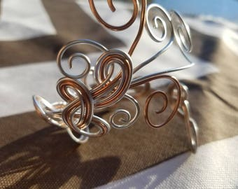 Silver and copper colored wire wrapped bracelet cuff
