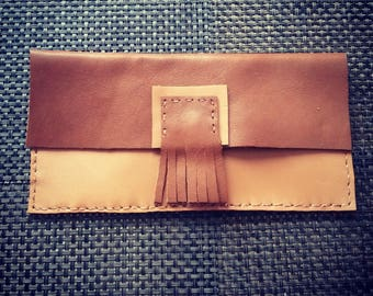 Brown and beige leather clutch