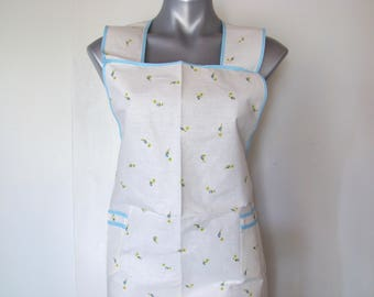Bib apron with pockets. Ties in back. Vintage 1970s; in new condition.