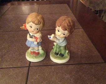 Girl and boy figurines