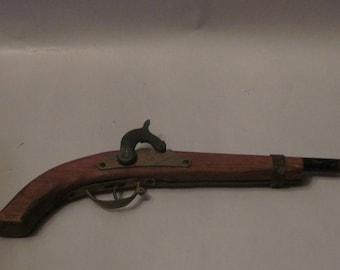 Toy dueling pistol, cap gun