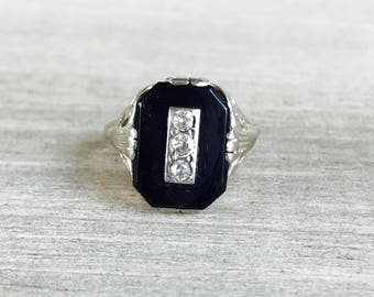 Vintage onyx and diamond ring in 14k white gold