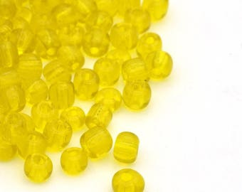 10g of transparent 4mm lemon yellow seed beads