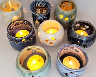 A selection of 8 decorative tea-light holders