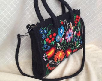 A small fancy handbag made of wool, decorated with hand-embroidered embroidery.