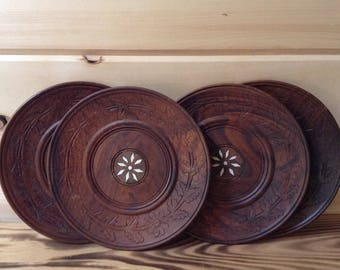 Set of 4 Vintage hand carved wood plates. Made in India.
