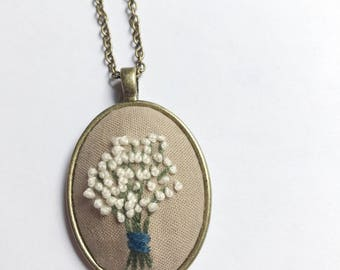 Baby's breath embroidered pendant