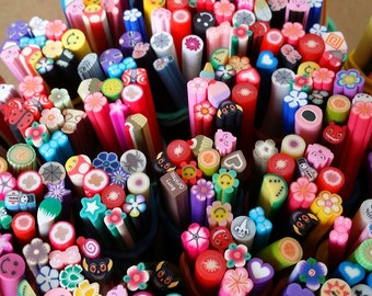 Set of 10 rods Fimo flowers and butterflies for scrapbooking, nail art, jewelry making and other creative work.