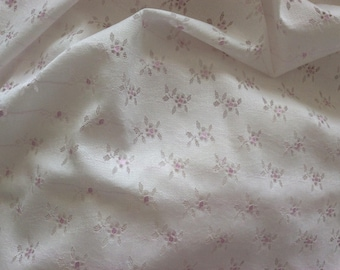 Fabric with tiny pink flower polyester