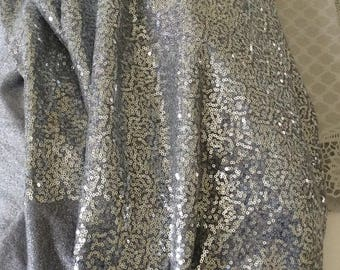 Fabric with sequins silver width 130