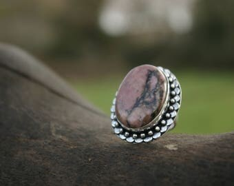 Ring size 56 rhodonite or 7.5 US, heals emotional wounds.