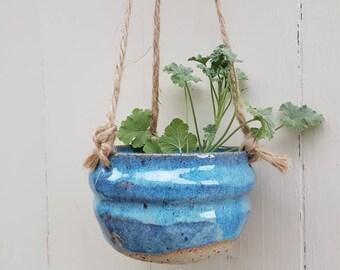 Rolling blue hanging planter