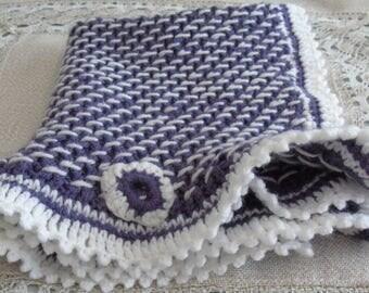 Handmade knitted purple and white baby blanket