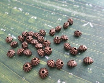set of 20 beads bicones 5 x 4 mm antique bronze
