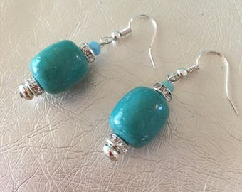 Turquoise earrings. Turquoise dangle earrings with crystal Turquoise drop earrings with crystal rondells.  Hanging on a silver ear wire.