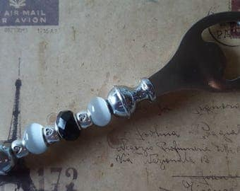 Metal bottle opener with beads