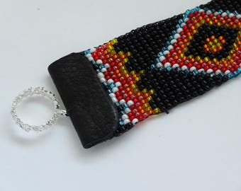 Hand loomed beaded bracelet Southwestern Indian motif in black, blue, gold, red, orange and white, silver clasp