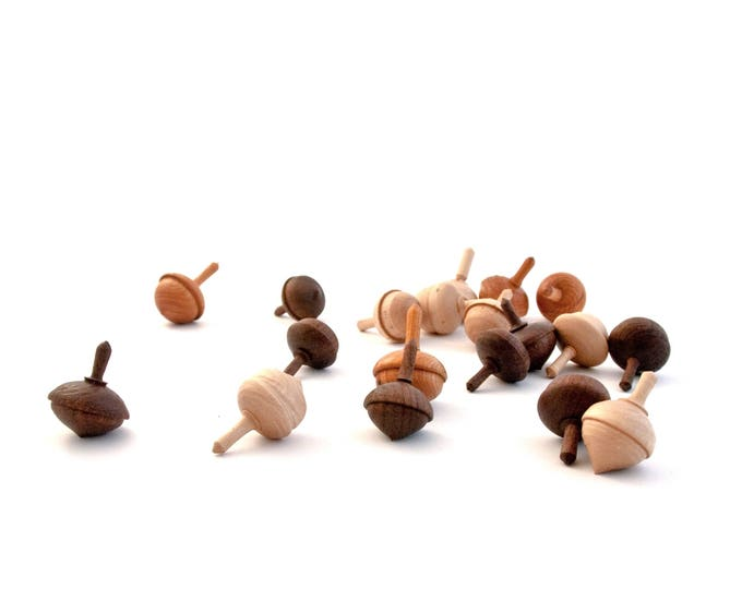 Set of three acorn spinning tops