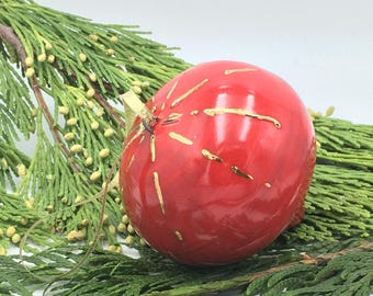 Red thrown ornament with top gold line details