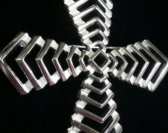 Crown Trifari silver tone windmill cross brooch