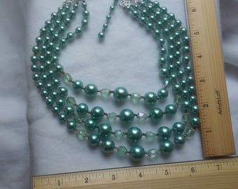 four strand teal pearl necklace