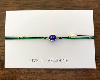 Delicate silver plated evil eye and pearl silk bracelet