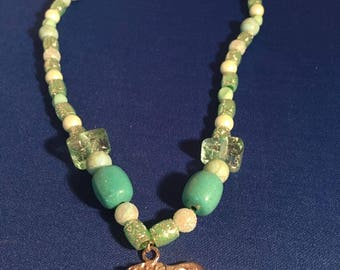 Handmade 21 inch turquoise color beaded necklace with elephant charm by Faithful Creations