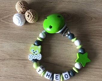 Pacifier Ti Green, white and Grey Wolf