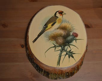 Vintage wooden bark wall plaque picture with European Gold Finch bird on thistles
