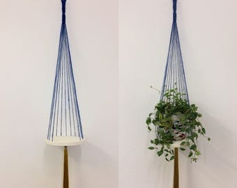Macrame hanging plant holder with wooden base