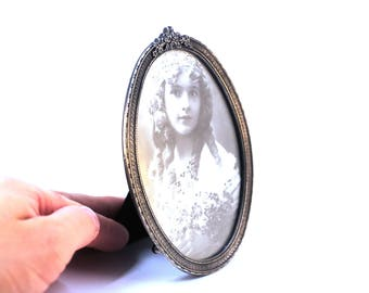 Vintage Metal Oval Frame with picture of beautiful women frame decorated with flowers ornaments