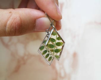 Earrings with small and gorgeous twig. Totally natural, green and tiny.