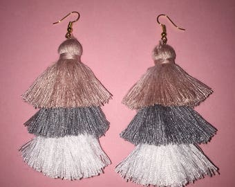 Pink, grey, and white tiered tassel earrings.