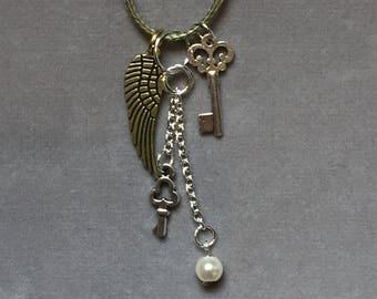 Wing and key charm and bead multi-tier pendant cord necklace