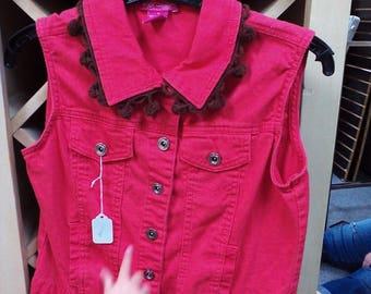 Salmon colored vest,with added pom pom trim